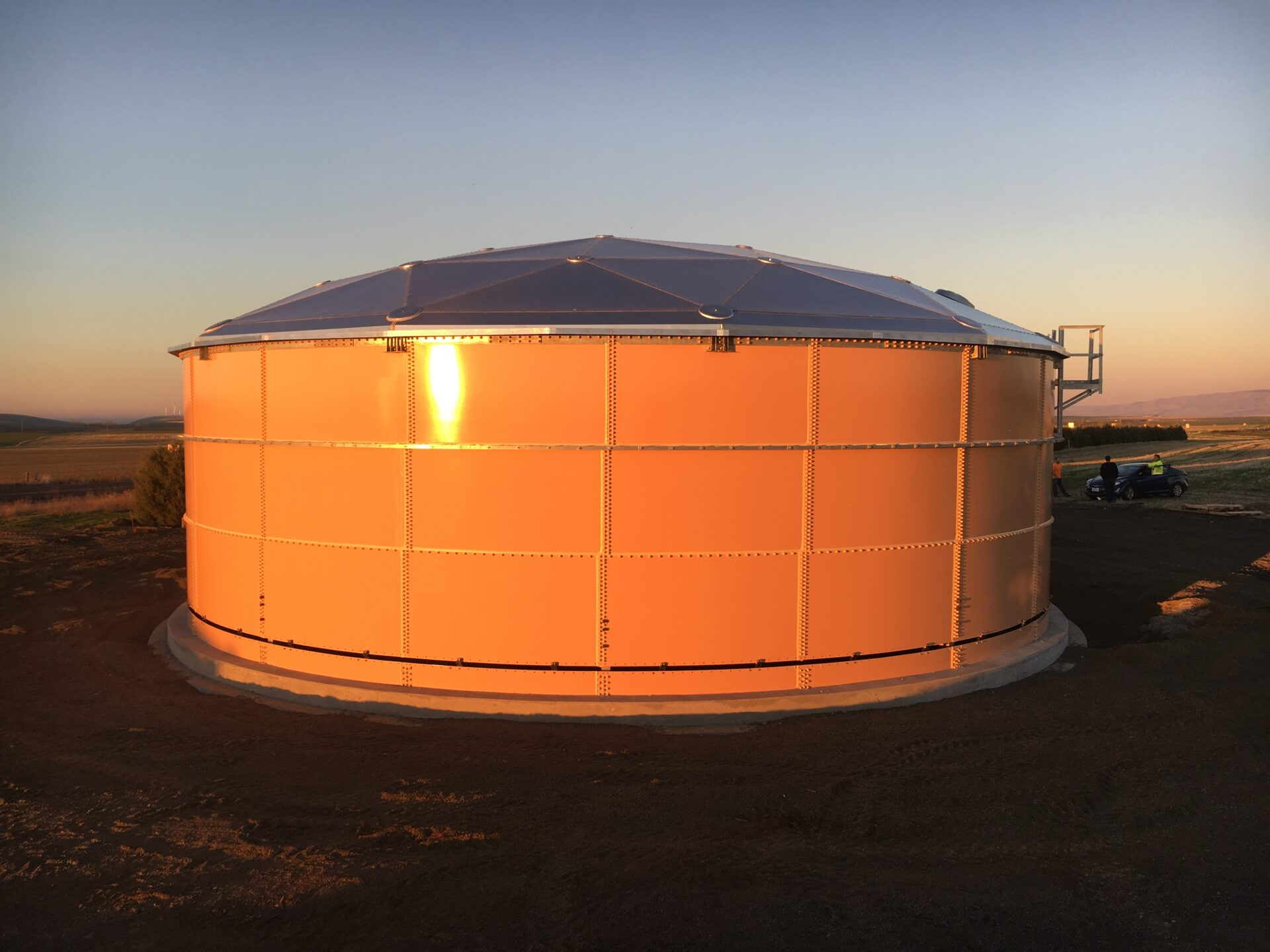 brown water tank at sunset