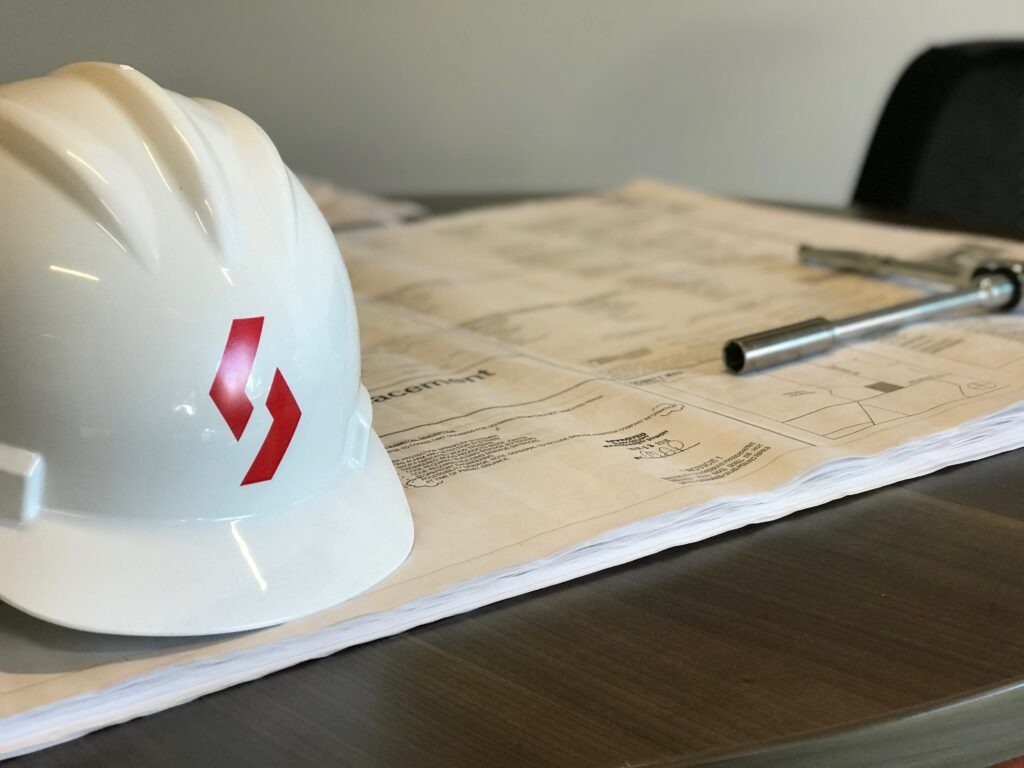 blueprints and hard hat