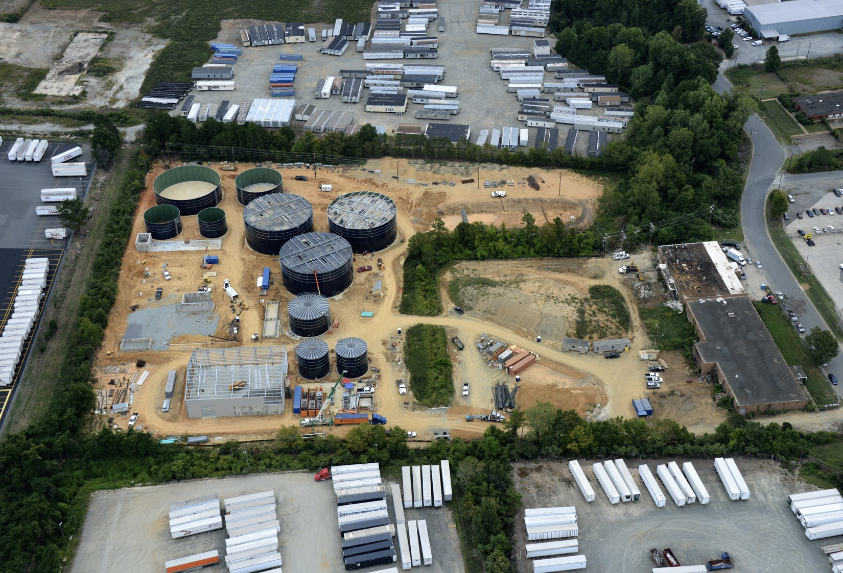 aerial shot of several water tanks being built