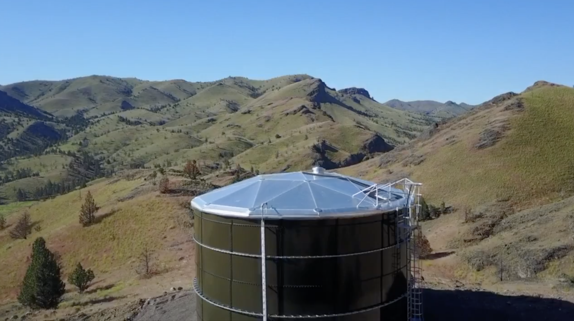black water tank in a hill